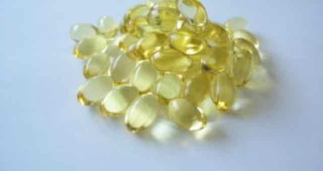 pilulas de vitamina D em uma mesa