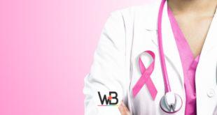 médica com simbolo do outubro rosa no peito para conscientizar o câncer de mama