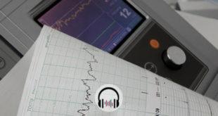 aparelho de eletrocardiograma com uma folha saindo, usado por cardiologia